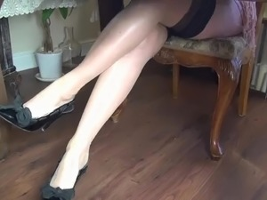 Pantyhose footjob under table