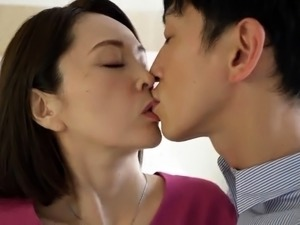 Charming Oriental mom surrenders her pussy to a young cock