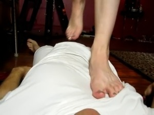 Mistress gives administers CBT and Trampling on her slave