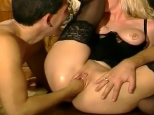 Blonde MILF sucks a pulsating rod with her wet mouth and then gets fisted and...