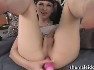 Sexy shemale Bailey Jay plays her dildo
