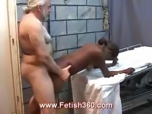 Ebony slut gets her ass spread with an anal speculum and banged by an old...