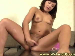 Petite pee fetish hottie squirms in pee in this HD video