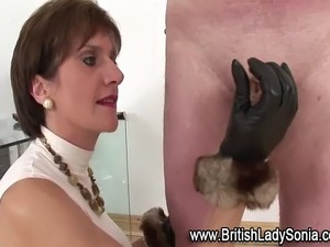 Femdom fetish mature Lady Sonia in fuck me boots jerks dick