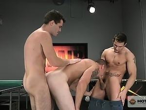 Phenix has his cock down Mark's throat while Trent fucks him