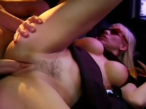 Lusty cock craving MILF getting fucked by a huge cock in a luxury limousine.