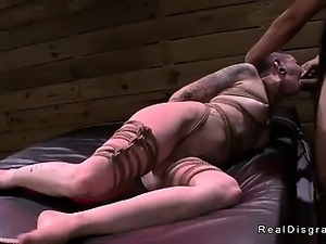 Tied up in rope tattooed redhead babe fucked