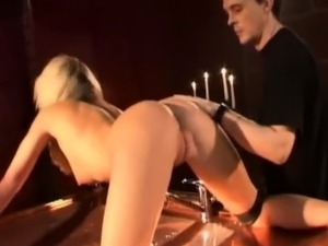 Blonde slave pained with hot water and candles