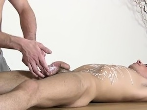 Twink sex Brit youngster Oli Jay is bound down to the table,