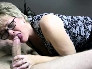 Glasses wearing mature on knees pov bj