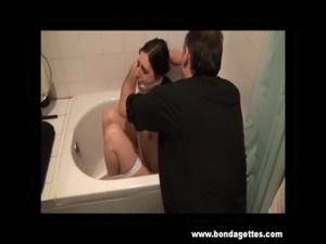 Bath bondage of submissive Honesty Cabellero in gagged restraints and wet...