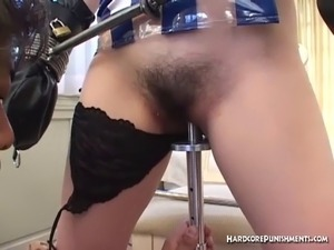 Chained and shackled hooded Oriental cheerleader pussy insertion