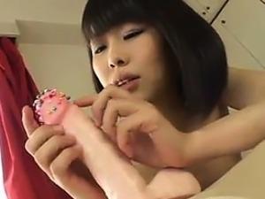 Sweet Asian Girl Abusing A Big Dildo