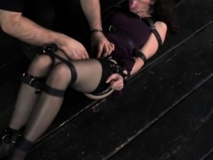 Gagged sub has her ass spanked by dom