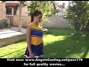 Adorable sexy redhead cheerleader showing tits