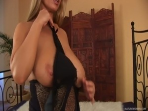 Beautiful blonde sexbomb squirts and moans while masturbating with a huge...