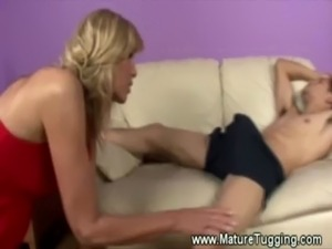 Horny blonde milf gives a hot handjob free