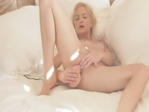 blonde beauty riding her pussy with toy