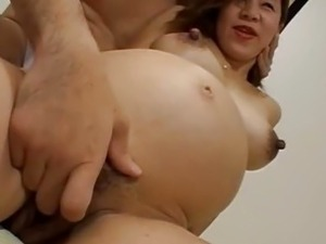 Pregnant Asian chick is fucked