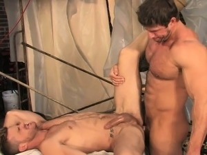 Construction worker Zeb towers over scruffy co-worker Landon