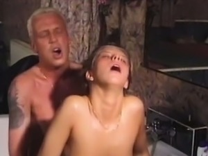 Petite blonde pissed on her tits and banged hard