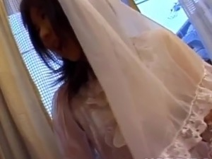 Nami Asakura inside wedding clothe polishes it nearby gloves