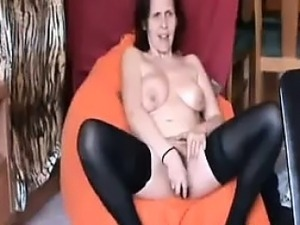mature housewife Sandy masturbates and cums