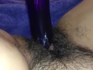Girl Masturbates with a Blue Dildo until She Squirts
