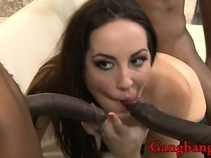 Sexy babe double penetrated by black men on the couch