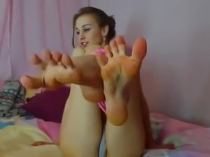 Pretty girl (ballerina) sucking her own toes
