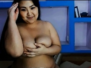 Chubby Oriental girl strips off all her clothes and display