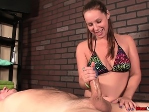 Pigtailed masseuse loves to work her gifted hands on a throbbing pole