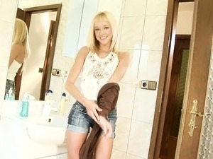 Shy blonde sensually drops her clothes and exposes her sexy slim body