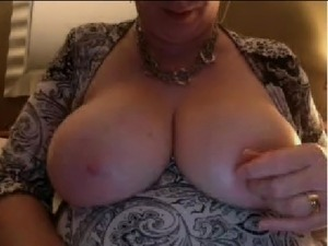 Married Mature Woman Flashes Her Enormous Tits on Webcam