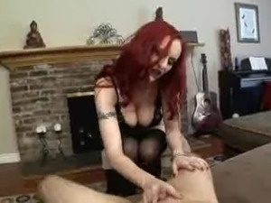 Red haired mistress and bisexual cuckolds giving head.