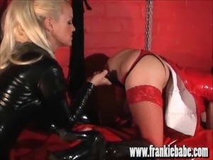 Sexy femdom spanks slavegirl ass and makes her fuck cock toy