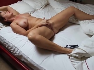 A milf in high heels masturbating