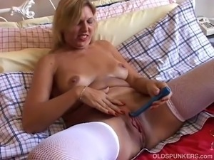 Gorgeous oldspunker with nice big tits and a beautiful body lies back and...