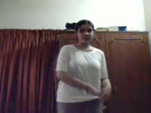 Fatty Indian teen playing with her huge boobies in a bathroom
