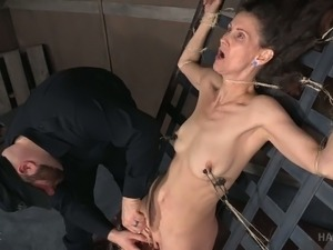 Mature whore Paintoy Emma is tied up and fucked with sex toys in the dark room