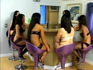 Asian girl in fishnets gets her pussy toyed and licked by several chicks