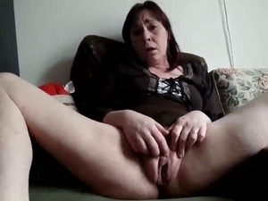 Sitting with pale legs spread apart bitchie brunette lady is ready for...