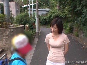 Helpful Japanese milf Nanako Mori gives hand to a man in a toilet