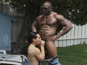 Muscled black stallion deeply drills a white guy's hungry ass outside