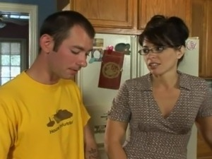 Doting milf in glasses delivers a blowjob then rides a dong hardcore