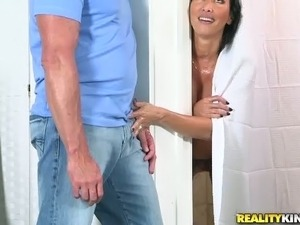 Slutty MILF with huge boobies is cheating on her man in the bathroom