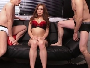 Dirty japanese slut is on her knees sucking two cocks