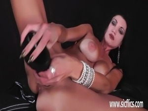 Busty milf fisted and fucked with a huge dildo