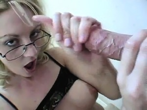 Busty blonde mom with glasses Sindy jacks off a throbbing dick in POV