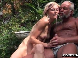 Bare boned blonde enjoys swallowing urine of one old man